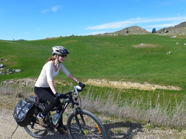 riding a bike on the Otago Central Rail Trail near Tiger Hill